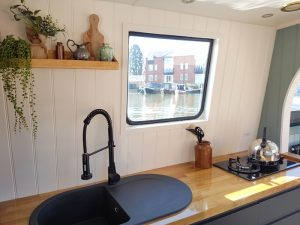Kitchen on electric Boutique Narrowboat in Market Harborough